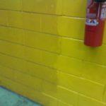 Dettaglio pulizia muro prima e dopo